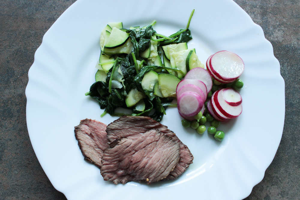 Blanched vegetables and roast beef
